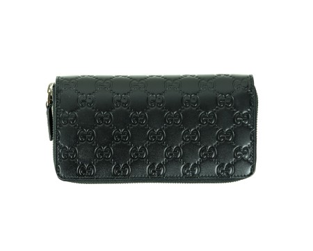 Shop GUCCI  Wallet: Black Gucci signature continental wallet. Closing with zip. Two compartments for cash and sixteen for credit cards and documents. Pocket with zip for coins. Size: width: 21cm; height: 11,5cm; depth: 2cm. Made in Italy.. 451194CWC1R-1000