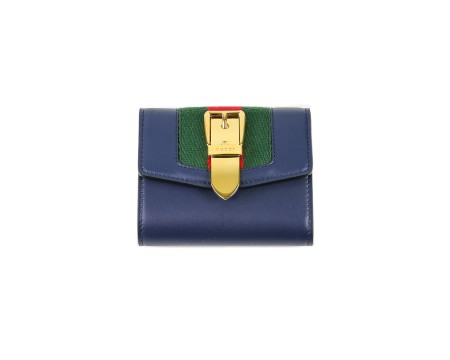 Shop GUCCI  Wallet: Gucci sylvie blue leather wallet. Red and green web detail with golden buckle application. Closing with button. Interior pocket for coins. One compartment for cash and four for credit cards or documents. Size: width: 11cm; height: 9,5cm; depth: 3cm. Made in Italy.. 476081CWLSG-4163