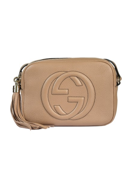 Shop GUCCI  Bag: Gucci beige small Soho Discobag bag in leather. GG embroidered detail. Adjustable shoulder belt. Zip closing. Red leather tassel with gold detail. Interior in cotton and linen with two pockets. Size: Width: 21cm; Height: 15cm; Depth: 7cm. Made in Italy.. 308364 A7M0G-2754