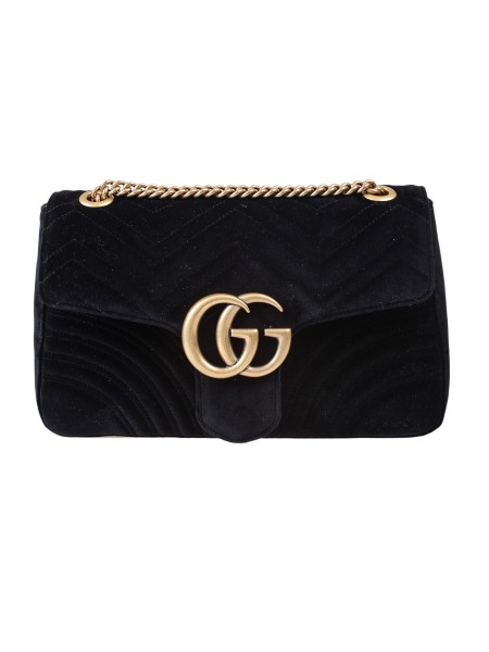 Shop GUCCI  Bag: Gucci Marmont medium GG bag in black velvet with chevron pattern and heart on the back. Antique gold-colored finishes. Double G. Detail Internal zipper and pockets for smartphones with open horizontal storage for large mobile phones. The sliding chain shoulder strap can be worn as a shoulder strap, height (light) 55cm, or with double handles, height (light) 30cm. Flap with spring closure. Dimensions medium size: Length 31 cm Height 19 cm Depth 7 cm. Silk lining. Made in Italy.. 443496 K4D2T -1000
