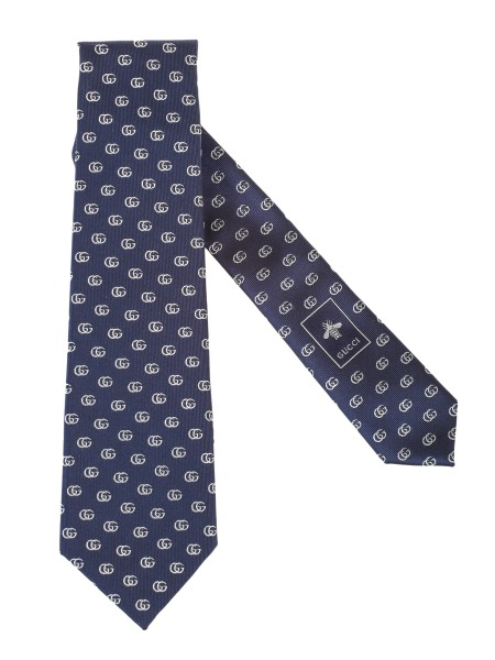 Shop GUCCI  Tie: Gucci Blue silk tie with double G ivory motif. Dimensions: Width 7 cm length 146 cm. Composition: 100% silk. Made in Italy.. 444421 4E002-4178