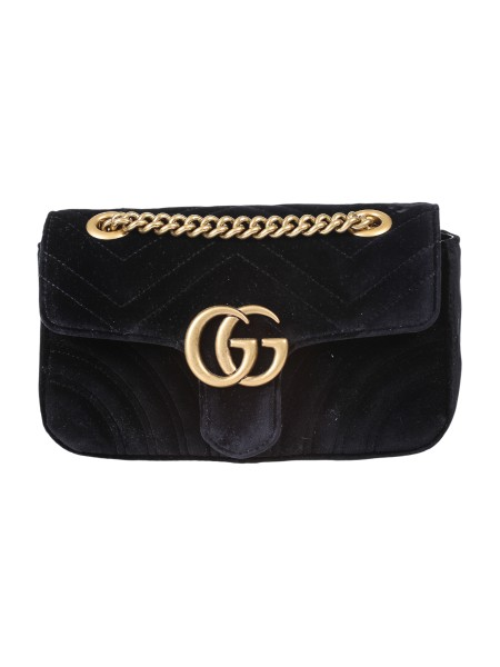 Shop GUCCI  Bag: Gucci Marmont mini GG bag in black velvet with chevron pattern and heart on the back. Antique gold-colored metal finishes. Double G. Detail Inside open pocket for large mobile phones. The sliding chain shoulder strap can be worn as a shoulder strap, height (light) 55cm, or with double handles, height (light) 30cm. Flap with spring closure. Dimensions Measure mini: Length 22 cm Height 13 cm Depth 6 cm. Silk lining. Made in Italy.. 446744 K4D2T-1000