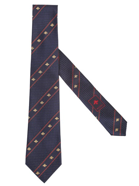 Shop GUCCI  Tie: Gucci blue silk tie with Web motif, striped green and red, and small golden bees. Dimensions: width 7 cm x length 146 cm. Composition: 100% silk. Made in Italy.. 451528 4E002-4074
