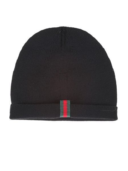 Shop GUCCI  Hat: Gucci black knitted wool hat with web detail on the back. Composition: 100% wool. Made in Italy.. 452398 4G498-1000