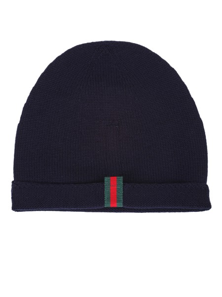 Shop GUCCI  Hat: Gucci blue knitted wool hat with web detail on the back. Composition: 100% wool. Made in Italy.. 452398 4G498-4000