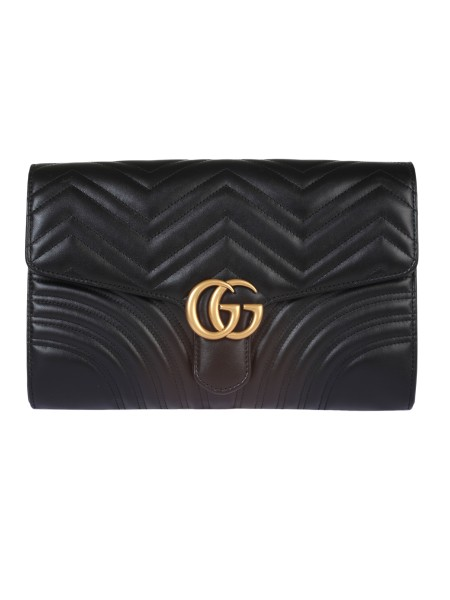 Shop GUCCI  Bag: Gucci Marmont oversized clutch bag in matelassé leather with chevron pattern. Quilted heart on the back. Antique gold-colored finishes. Double G. Open back pocket. Open pockets and internal zipper. Flap with magnetic closure. Dimensions: Length 30 cm Height 20 cm Depth 5 cm. Suede effect microfibre lining. Made in Italy.. 498079 DTDIT-1000