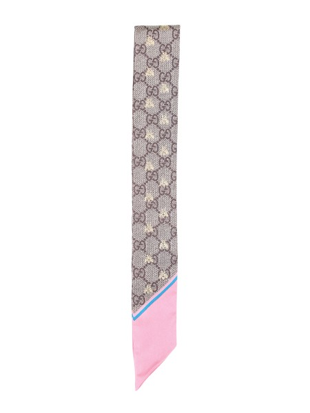 Shop GUCCI  Scarf: Gucci ribbon in silk twill with GG pattern and gold-colored print depicting the bees completed with pink edges. Dimensions: Width 5 cm length 86 cm. Composition: 100% silk. Made in Italy.. 499226 3G001-5869