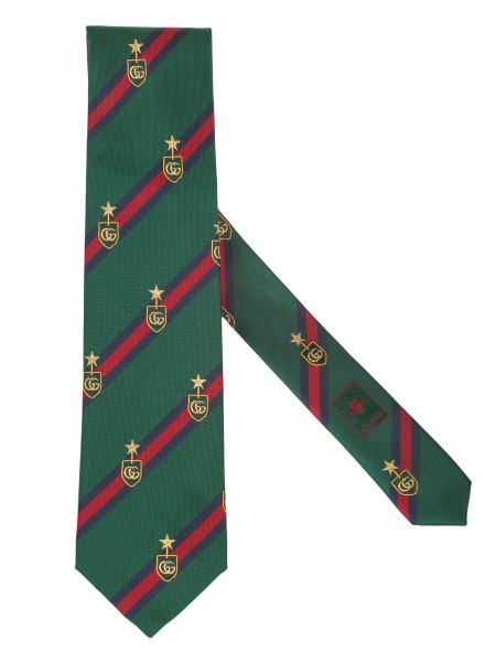 Shop GUCCI  Tie: Gucci tie in green silk, with blue and red web motif stripes and double G. badge. Dimensions: Width 8 cm x length 148.5.cm. Composition: 97% silk, 2% polyester and 1% metallic fiber. Made in Italy.. 521716 4B744-3168