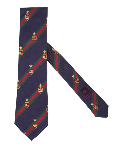 Shop GUCCI  Tie: Gucci tie in navy blue silk, with green and red web motif lines and double G. badge. Dimensions: Width 8 cm x length 148.5cm. Composition: 97% silk, 2% polyester and 1% metallic fiber. Made in Italy.. 521716 4B744-4166