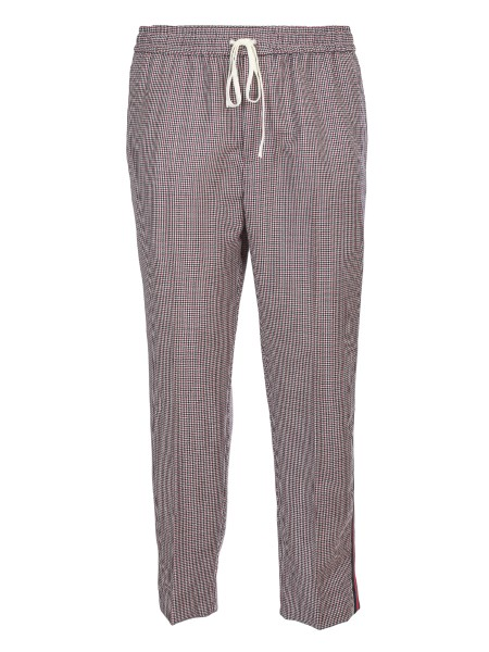 Shop GUCCI  Trousers: Gucci pants in white, black and red mohair wool with houndstooth pattern. Green and red web ribbon on the leg. Elasticated belt with drawstring. American front pockets. Back pockets with flap. Trousers: leg bottom 38 cm. Composition: 88% wool 12% mohair. Made in Italy.. 522947 Z542J -9152