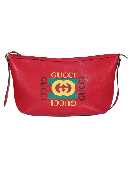 Shop GUCCI  Shoulder Bag: Gucci half-moon bag in dark red leather and vintage logo. This bag represents a streetwear reinterpretation of the historic hobo bag. Brass finishes. Inside pocket with zipper. Adjustable shoulder strap in leather, height (light) 39 cm. Zipper closure. Dimensions: Length 47.5 cm Height 29 cm Depth 9 cm. Cotton and linen lining. Made in Italy.. 523588 0GDAT-6461