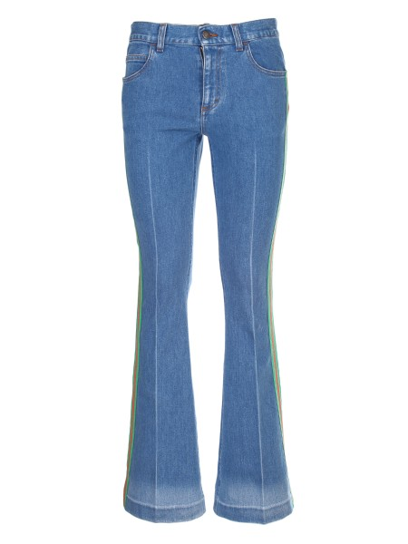 Shop GUCCI  Jeans: Gucci blue stretch denim with solarized effect with stone-washed treatment and green and red web ribbon on both sides. Gucci leather label. Five-pocket cut. Button closure. Composition: 98% cotton and 2% elastane. Made in Italy.. 527432 XRB36-4677