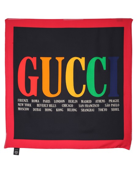 Shop GUCCI  Headscarf: Gucci scarf in black silk twill with Gucci Cities print. Red borders. Edges with hand finishes. Dimensions: 90 cm x 90 cm. Composition: 100% silk. Made in Italy.. 528952 3G001-9888