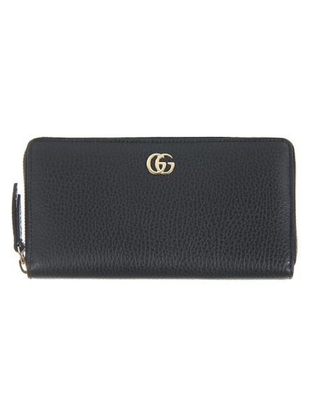 Shop GUCCI  Wallet: Gucci black leather wallet with zip and golden G metal detail. Twelve card slots and three bill compartments. Coin pocket with zipper. Zipper closure. Length: 19.5cm x Height: 11cm x Depth: 3cm. Made in Italy.. 456117 CAO0G-1000