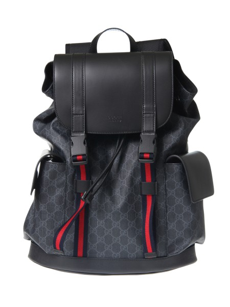 Shop GUCCI  Backpack: Gucci backpack in soft GG Supreme black and gray fabric. Microfibre coating. Black leather finishes. Blue and red web detail. Internal closure with nylon drawstring. Back in black mesh, breathable. Side pockets with flap and automatic magnetic closure. Padded compartment for iPad. Smartphone pockets. Adjustable padded shoulder straps with mesh back. Closure with flap and shoulder straps with buckle. Dimensions: Length 34 cm Height 42 cm Depth 16 cm. Nylon lining. Made in Italy.. 495563 K9R8X-1071
