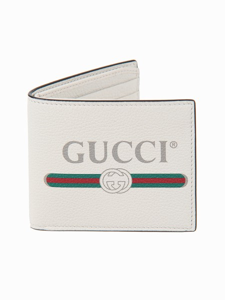 Shop GUCCI  Wallet: Gucci wallet in white leather with vintage logo print, inspired by the fashion of the 80s. Eight card slots and two bill compartments. Open: L21cm x A9cm. Closed: L11cm x A9cm. Made in Italy.. 496309 0GCAT-8820