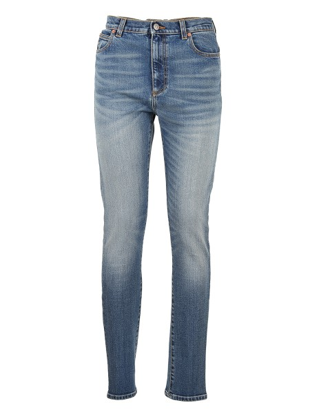 Shop GUCCI Sales Jeans: Gucci Japanese denim light blue marble effect. Print Gucci stamp on the back. Leather label with eye print. High waist. Fitted on the leg. Adherent to the ankle. Bottom leg in size 26 15cm. Composition: 98% cotton, 2% polyurethane. Made in Italy.. 502797 XD740-4486
