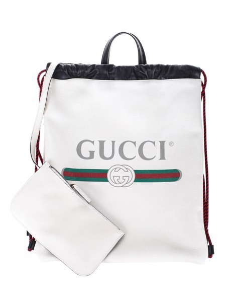 Shop GUCCI  Backpack: Gucci backpack, white, in leather. Print with iconic 80s logo. Inner pouch. Double leather handle in black. Drawstring on the edge. Laces, adjustable, in rope. Made in Italy.. 516639 0GCBT -8821