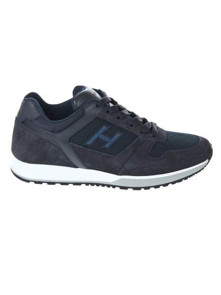 Shop HOGAN  Shoes: Hogan H321 sneakers in blue leather and suede. Upper in leather and suede. Technical fabric inserts. Details in scuba effect fabric. H side in relief. Rubber sole. Fabric case included. Made in Italy.. HXM3210Y861II5-961R