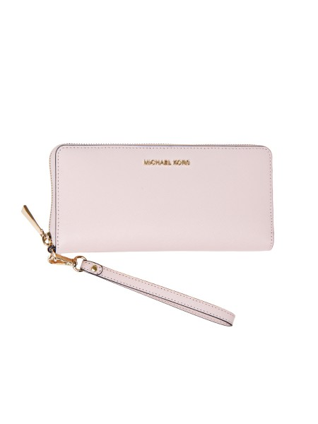 "Shop MICHAEL KORS  Wallet: Michael Michael Kors ""Jet Set Travel"" wrist bag in pink leather. Composition: 100% Saffiano leather Logo in golden metal. Dimensions: Length 21 cm Height 10 cm Depth 2 cm. Height of the handle: 17.8 cm Inside: one zip pocket, three slit pockets, ten credit card slots Lining: 100% polyester. Top zip closure.. 32S5GTVE9L MONEY PIECES-187"