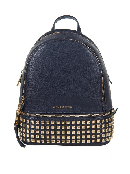 Shop MICHAEL KORS  Backpack: Michael Kors backpack in blue leather with golden studs. 100% leather. Metal details in gold tones. Width 25.4 cm Height 29.8 cm Depth 11.4 cm. Height of the handle: 5.1 cm Adjustable shoulder strap: 20.3-22.9 cm. Compatible with iPad and iPad Mini. Exterior details: two zip pockets. Internal details: a padded tablet compartment, a zip pocket, a key ring. Lining: 100% polyester. Top zip closure.. RHEA ZIP 30S5GEZB5L-414