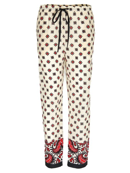 Shop RED VALENTINO Trousers: Red Valentino pants in silk Bandhana print.
